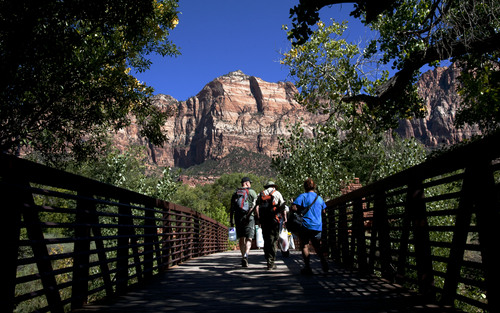 Steve Griffin  |  The Salt Lake Tribune  Park goers cross the footbridge to the walk in entrance to  Zion National Park near Springdale, Utah Monday, September 30, 2013. A looming federal government shutdown could close all National Parks.