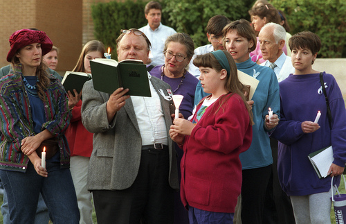 Al Hartmann | Tribune file photo Supporters of Lynne Whitesides hold a vigil outside her LDS Church disciplinary hearing in 1993.