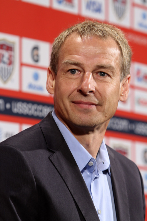 Juergen Klinsmann, of Germany, smiles after being introduced as the head coach of the U.S. men's soccer team at a news conference in New York, Monday, Aug. 1, 2011.  (AP Photo/Mary Altaffer)