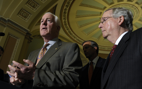 Senate Minority Leader Mitch McConnell of Ky., listens at right as Senate Minority Whip John Cornyn of Texas, left, speaks to reporters on Capitol Hill in Washington, Tuesday, Oct. 1, 2013, following a policy luncheon. Lawmakers on Capitol Hill continue to scramble to reach agreement on funding the federal government.  (AP Photo/Susan Walsh)