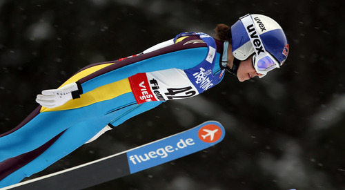 Sarah Hendrickson of the United States  soars through the air to win the women's ski jumping HS 106 Individual at the Nordic Ski World Championships in Val di Fiemme, Italy, Friday, Feb. 22, 2013.  (AP Photo/Matthias Schrader)