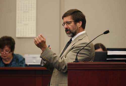 Scott Sommerdorf   |  The Salt Lake Tribune Defense attorney Fred Metos makes a slashing motion across his wrist to simulate what might have occured in a suicide attempt, during the three-day preliminary hearing for John Brickman Wall, a Salt Lake City pediatrician charged in 3rd District Court with first-degree felony counts of murder and aggravated burglary in connection with the October 2011 death of his ex-wife, Uta von Schwedler, Wednesday, October 2, 2013.