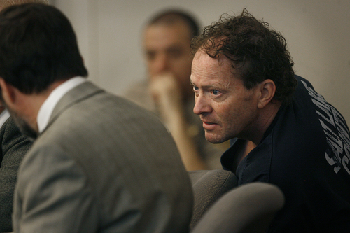 Scott Sommerdorf   |  The Salt Lake Tribune John Brickman Wallon Wednesday leans over to confer with his attorney Fred Metos, left, during his three-day preliminary hearing. The Salt Lake City pediatrician is charged in 3rd District Court with first-degree felony counts of murder and aggravated burglary in connection with the October 2011 death of his ex-wife, Uta von Schwedler.