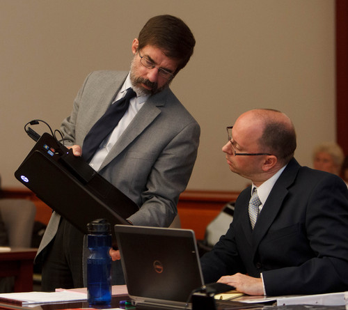 Trent Nelson  |  The Salt Lake Tribune Defense attorney Frank Metos, left, and prosecutor Matt Janzen at a preliminary hearing for John Brickman Wall in Salt Lake City, Tuesday, October 1, 2013. Wall is a pediatrician charged in 3rd District Court with first-degree felony counts of murder and aggravated burglary in connection with the October 2011 death of his ex-wife, Uta von Schwedler.
