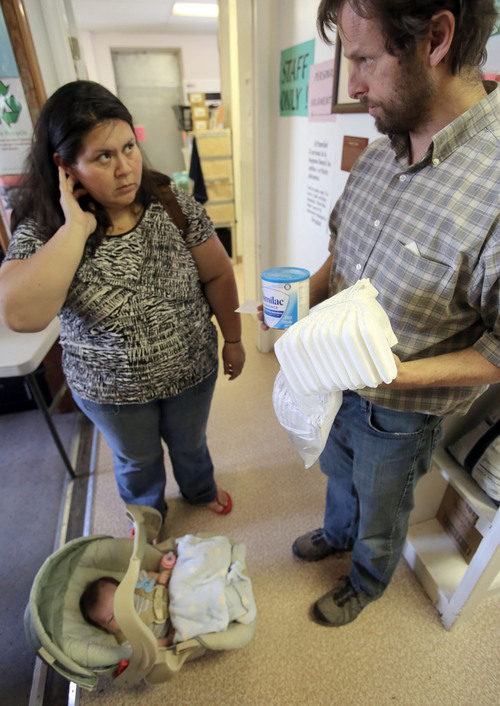 Francisco Kjolseth  |  The Salt Lake Tribune Alejandra Castro, 34, of Midvale is surprised to find out she can only get one can of baby formula for her 6-week-old son as she speaks with Bill Tibbitts, Assoc. Director for the Crossroads Urban Center. With the federal shutdown taking effect, the repercussions are being manifest from the bottom up as women who rely on the federally funded WIC (Women, Infants and Children) are unable to get baby formula, which is where Castro normally gets a voucher for nine cans a month. It will be three days before she can return for another can, which means time and money traveling back and forth.