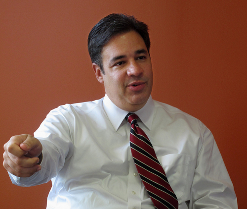 FILE - In this Sept. 4, 2013 file photo, Rep. Raul Labrador, R-Idaho is interviewed by The Associated Press in Boise, Idaho. The government shutdown could last for many days or even weeks, congressional insiders say, because politically safe members in both parties feel little pressure to compromise. Recent political trends -- including heavily gerrymandered districts that make many House Democrats and Republicans virtual shoo-ins for re-election -- insulate lawmakers from events and emotions beyond their home regions. Gerrymandering has existed for decades. But election results and lawmakers' voting patterns show that the House is more sharply divided along party lines than at almost any point in modern times.  (AP Photo/John Miller, File)