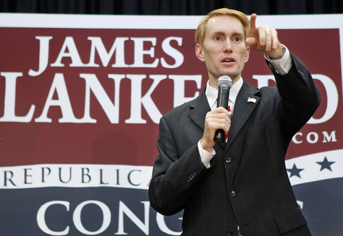 FILE - This Aug. 24, 2010 file photo shows then Oklahoma House candidate, Now. Rep.James Lankford speaking in Oklahoma City. The government shutdown could last for many days or even weeks, congressional insiders say, because politically safe members in both parties feel little pressure to compromise. Recent political trends -- including heavily gerrymandered districts that make many House Democrats and Republicans virtual shoo-ins for re-election -- insulate lawmakers from events and emotions beyond their home regions. Gerrymandering has existed for decades. But election results and lawmakers' voting patterns show that the House is more sharply divided along party lines than at almost any point in modern times.  (AP Photo/Sue Ogrocki, File)