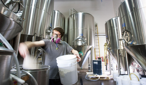 Steve Griffin  |  The Salt Lake Tribune Epic Brewery cellarman, Jeff Bunk, loads a beer filter at the Salt Lake City, Utah brewery on Wednesday.