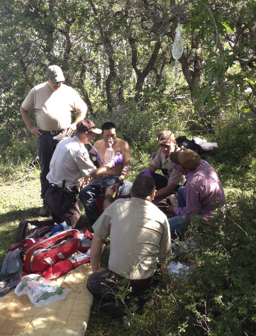 | Courtesy Utah Division of Wildlife Resources Utah Division of Wildlife Resources law officers and biologists help a sheepherder Wednesday who had been gored by a bull elk on Tuesday on the LaSal Mountains east of Moab.