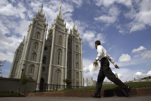 Temple Square had its usual flurry of activity on Thursday as the LDS Church nears its fall conference.    Photo by Francisco Kjolseth/The Salt Lake Tribune 09/30/2004