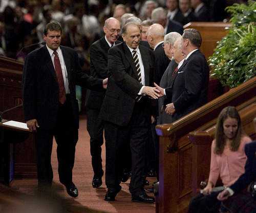 Jeremy Harmon  |  The Salt Lake Tribune  President Thomas S. Monson shakes hands with members of the Quorum of the Twelve as he leaves the Conference Center following the Saturday morning session of the 181st Semiannual General Conference of The Church of Jesus Christ of Latter-day Saints on Saturday, Oct. 1, 2011.