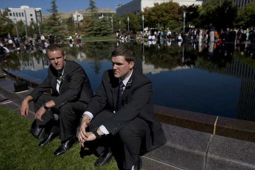 Kim Raff | The Salt Lake Tribune LDS missionaries Elders Tyler McCord, left, and Devin Duke sit by the reflecting pool at Temple Square during the 183rd General Conference of the LDS Church in Salt Lake City, Utah, on Oct. 7, 2012. The day before, church President Thomas S. Monson had announced lower age limits for Mormon missionaries -- 18 (down from 19) for men and 19 (down from 21) for women.