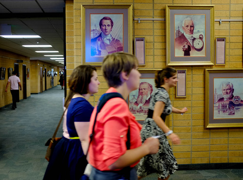 Trent Nelson  |  The Salt Lake Tribune Missionaries walk past portraits of past church leaders at the Missionary Training Center of The Church of Jesus Christ of Latter-day Saints in Provo Tuesday June 18, 2013.