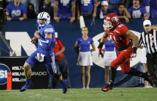 Rick Egan  | The Salt Lake Tribune   Quarterback Taysom Hill (4) outruns Utah Utes linebacker Jared Norris (41)as BYU faced The University of Utah, at Lavell Edwards Stadium, Saturday, September 21, 2013.