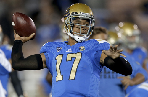 UCLA quarterback Brett Hundley warms up for an NCAA college football game against New Mexico State on Saturday, Sept. 21, 2013, in Pasadena, Calif. (AP Photo/Chris Carlson)