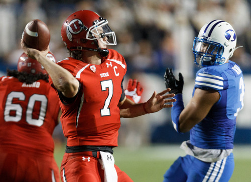 Trent Nelson  |  The Salt Lake Tribune Utah Utes quarterback Travis Wilson (7) throws the ball in the fourth quarter as the BYU Cougars host the Utah Utes, college football Saturday, September 21, 2013 at LaVell Edwards Stadium in Provo.