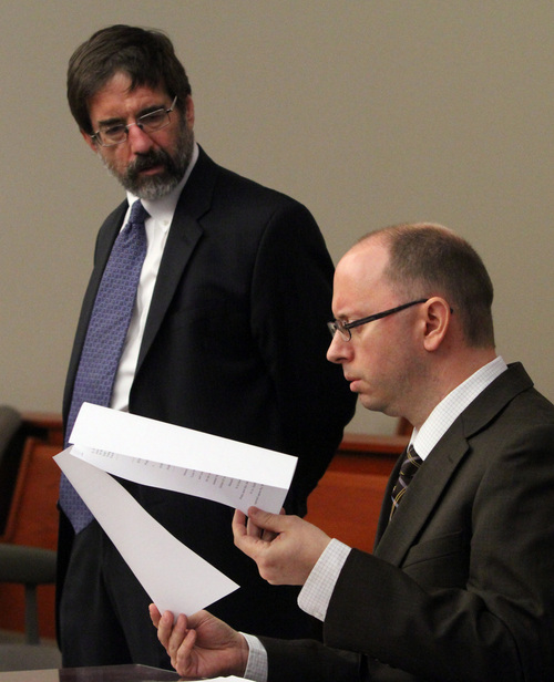 Rick Egan  | The Salt Lake Tribune   John Brickman Wall's attorney Fred Metos (left) and Salt Lake County prosecutor, Matt Janzen (right) in the courtroom on the third day of Wall's preliminary hearing at the Matheson Courthouse, Thursday, October 3, 2013. Wall is charged in 3rd District Court with first-degree felony counts of murder and aggravated burglary in connection with the October 2011 death of his ex-wife, Uta von Schwedler.