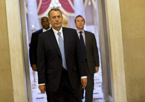 House Speaker John Boehner of Ohio walks to his office on Capitol Hill in Washington, Wednesday, Oct. 2, 2013. The Republican-run House has rejected an effort by Democrats to force a quick end to the partial government shutdown. By a 227-197 vote Wednesday, the House rejected a move by Democrats aimed at forcing the House to vote on immediately reopening the government without clamping any restrictions on President Barack Obama's health care law.   (AP Photo/ Evan Vucci)