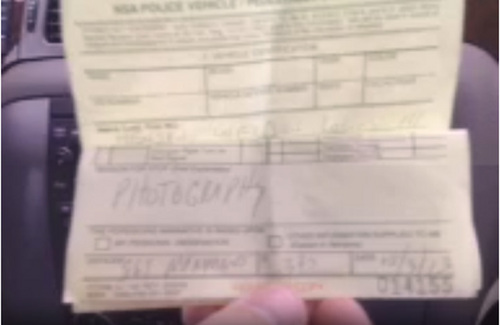 Anthony Gucciardi shows the written warning he received from NSA security for entering and filming the parking lot of the Utah Data Center on Oct. 3, 2013.  Courtesy Anthony Gucciardi