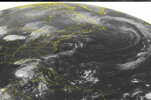 This NOAA satellite image taken Friday, Oct. 4, 2013 at 1:45 a.m. EDT shows Tropical Storm Karen in the Gulf of Mexico tracking northward with maximum sustained winds of 65 mph. A low pressure system is tracking across the central United States with showers and thunderstorms into the Mid West. Areas of showers extend into the Great Lakes.  (AP PHOTO/WEATHER UNDERGROUND)