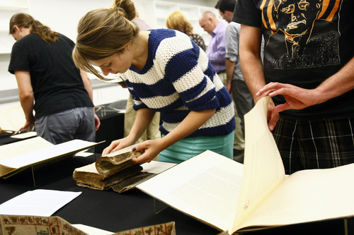 Chris Detrick  |  The Salt Lake Tribune Junior Isa Hanswille looks at historical books at the University of Utah's Special Collections Department in the J. Willard Marriott Library Tuesday September 17, 2013. The students are enrolled in the University of Utah's first academic course dedicated to studying the Book of Mormon as a work of literature.