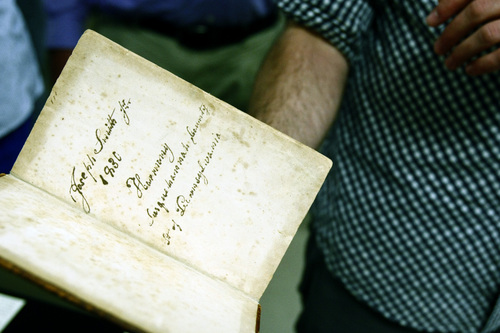 Chris Detrick  |  The Salt Lake Tribune Junior Colby Townsend looks at an original 1830 edition of the Book of Mormon signed by Joseph Smith Jr. at the University of Utah's Special Collections Department in the J. Willard Marriott Library Tuesday September 17, 2013. The students are enrolled in the University of Utah's first academic course dedicated to studying the Book of Mormon as a work of literature.