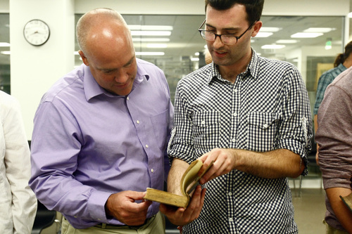 Chris Detrick  |  The Salt Lake Tribune Dr. David Bokovoy and Junior Colby Townsend look at a first edition of Noah Webster's English Dictionary at the University of Utah's Special Collections Department in the J. Willard Marriott Library Tuesday September 17, 2013. The students are enrolled in the University of Utah's first academic course dedicated to studying the Book of Mormon as a work of literature.