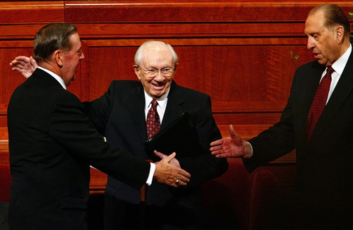 President Gordon B. Hinckley, center,  pats  Elder Jeffrey R. Holland, left, of the Quorum of the Twelve Apostles on the back as he shakes hands with President Thomas S. Monson has served as a Counselor in the First Presidency.  Hinckley closed the 176th Semiannual General Conference of the LDS Church that is held at the LDS Conference Center in Salt Lake City, UT. Members from near and far come to attend and listen to Church leaders speak. (Danny Chan La/The Salt Lake Tribune) 10-21-2006