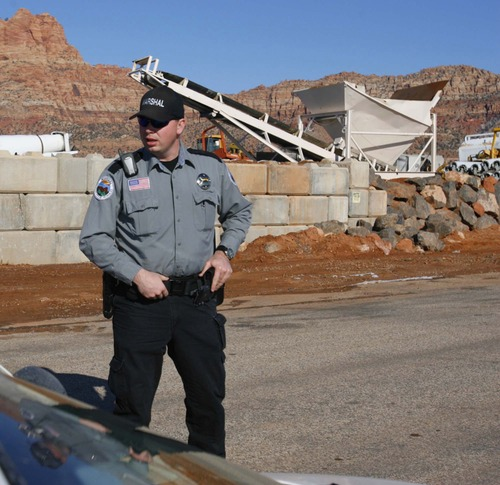Trent Nelson  |  Tribune file photo Preston Barlow, an FLDS member and marshal with the Hildale/Colorado City Town Marshals, in Hildale on Dec. 20, 2006.
