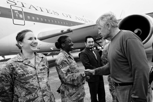 U.S. Air Force Staff Sgt. Sheri Nolen, left, and Staff Sgt. Denise Burris are greeted by U.S. Secretary of Defense Chuck Hagel, as he leaves Japan to return to the U.S. from Yokota Air Base on Friday Oct. 4, 2013, ending his trip to South Korea and Japan. (AP Photo/Jacquelyn Martin, Pool)