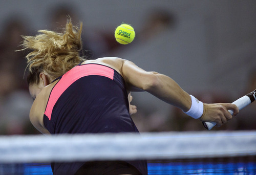 A ball, returned by Serena Williams of U.S., hits Agnieszka Radwanska of Poland during their semifinal match of the China Open tennis tournament at the National Tennis Stadium in Beijing, China Saturday, Oct. 5, 2013. (AP Photo/Andy Wong)