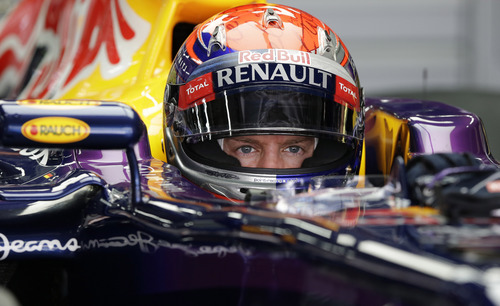 Red Bull driver Sebastian Vettel of Germany waits in his car during the third practice session at the Korean Formula One Grand Prix at the Korean International Circuit in Yeongam, South Korea, Saturday, Oct. 5, 2013. (AP Photo/Mark Baker)