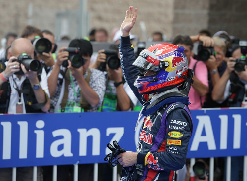 Red Bull driver Sebastian Vettel of Germany gestures as he celebrates after qualifying in pole position at the Korean Formula One Grand Prix at the Korean International Circuit in Yeongam, South Korea, Saturday, Oct. 5, 2013. (AP Photo/Aaron Favila)