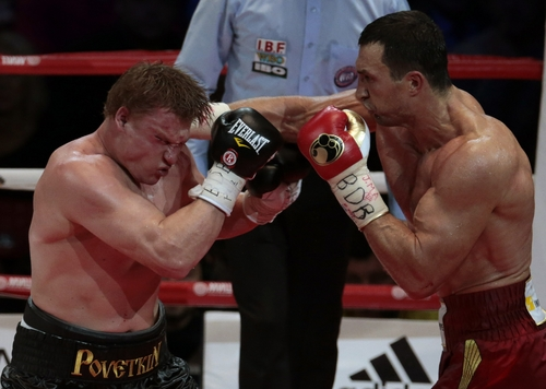 Heavyweight champion Wladimir Klitschko, of Ukraine, right, hits Alexander Povetkin, of Russia, during their bout at the Olympic Stadium, in Moscow, Russia, on Saturday, Oct. 5, 2013. Wladimir Klitschko successfully defended his WBA and IBF titles. (AP Photo/Ivan Sekretarev)