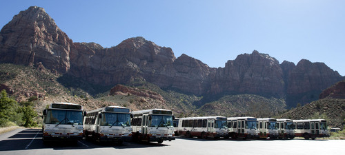 Steve Griffin  |  The Salt Lake Tribune  Shuttle buses are parked in a lot at Zion National Park following the federal government shutdown Tuesday, October 1, 2013.