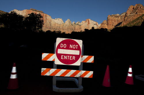 Steve Griffin  |  The Salt Lake Tribune  Signs block the entrance to the Zion Human History Museum in Zion National Park due to the federal government shutdown Tuesday October 1, 2013.