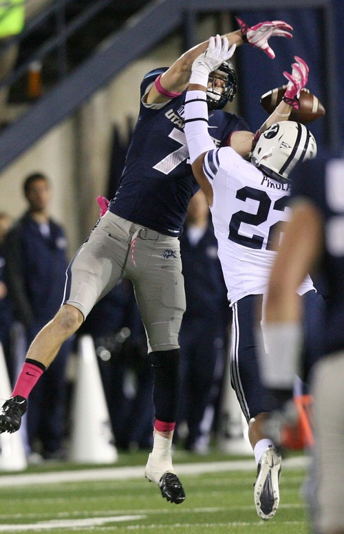 Leah Hogsten | The Salt Lake Tribune Utah State Aggies wide receiver Travis Van Leeuwen (7) can't get the catch above Brigham Young Cougars linebacker Manoa Pikula (22).  Brigham Young University Cougars defeatd Utah State University Aggies 31-14, Friday, October 4, 2013 in Logan.