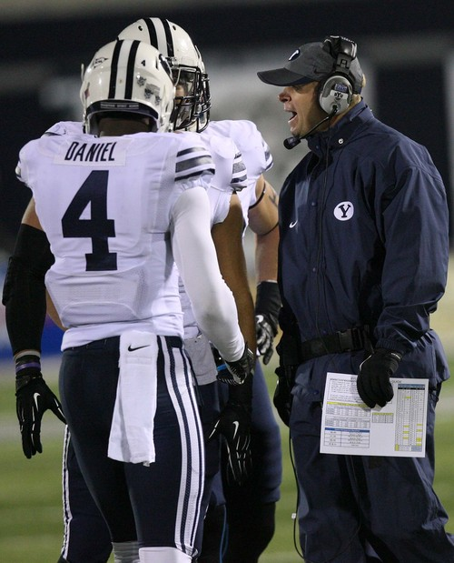 Leah Hogsten | The Salt Lake Tribune BYU head coach Bronco Mendenhall talks with and Brigham Young Cougars defensive back Robertson Daniel (4). Brigham Young Cougars linebacker Kyle Van Noy (3) Brigham Young University Cougars defeatd Utah State University Aggies 31-14, Friday, October 4, 2013 in Logan.