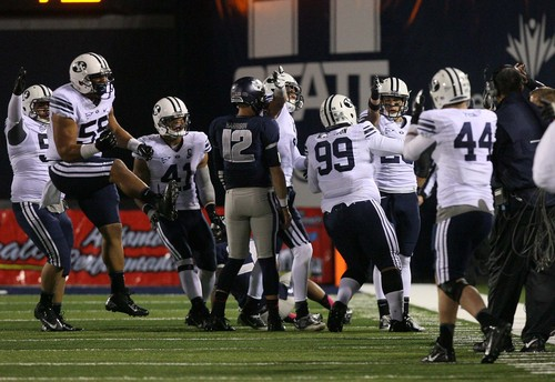 Leah Hogsten | The Salt Lake Tribune Utah State Aggies running back Rashad Hall (20) celebrates his interception in the second half.  Brigham Young University Cougars defeatd Utah State University Aggies 31-14, Friday, October 4, 2013 in Logan.
