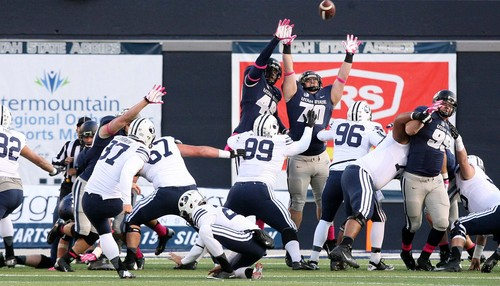 Leah Hogsten | The Salt Lake Tribune Brigham Young Cougars kicker Justin Sorensen (37) for the goal in the first. Brigham Young University Cougars lead 10-7 after the first quarter during their matchup against  Utah State University Aggies  Friday, October 4, 2013 in Logan.