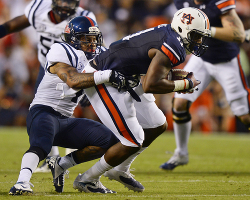 Auburn's Brandon Fulse, right, is tackled by Mississippi defender Denzel Nkemdiche during the first half of an NCAA college football game on Saturday, Oct. 5, 2013 in Auburn, Ala. (AP Photo/Todd J. Van Emst)