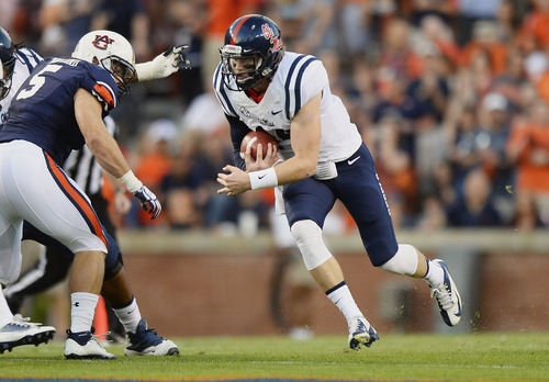 Mississippi quarterback Bo Wallace runs against Auburn in the first half of an NCAA college football game Saturday, Oct. 5, 2013, in Auburn, Ala. (AP Photo/Todd J. Van Emst)
