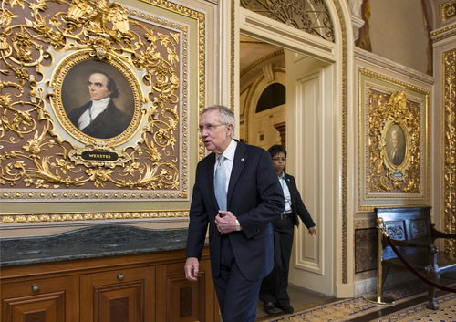 With the government shutdown still unresolved, Senate Majority Leader Harry Reid, D-Nev., leaves the chamber at the end the day, Saturday, Oct. 5, 2013, at the Capitol in Washington. There has been no sign of progress toward ending an impasse that has idled 800,000 federal workers and curbed services around the country. (AP Photo/J. Scott Applewhite)