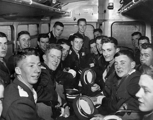 ADVANCE FOR USE SATURDAY, OCT. 5, 2013 AND THEREAFTER - In this November 1963 photo provided by the Irish Defence Forces Bureau of Military History, members of the Irish cadet honor guard sit together in a bus after returning to Ireland from Washington. The cadets - 18- and 19-year-old soldiers - had been whisked from their remote barracks in County Kildare and were flown to the U.S. to perform a special ceremonial drill at the funeral of U.S. President John F. Kennedy. He had been captivated by the drill when he saw it performed in Dublin months earlier. (AP Photo/Irish Defence Forces Bureau of Military History)