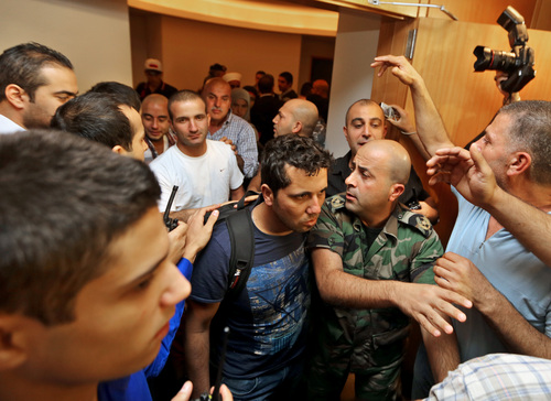 Lebanese survivors of a boat that sunk on its way toward Australia arrive at Rafik Hariri International Airport in Beirut, Lebanon, Sunday, Oct. 6, 2013. The Lebanese men from the impoverished northern district of Akkar were seeking to claim asylum in Australia when their boat broke apart and sunk in late September. Australian media reported that at least 31 people drowned and 22 survived. (AP Photo/Bilal Hussein)