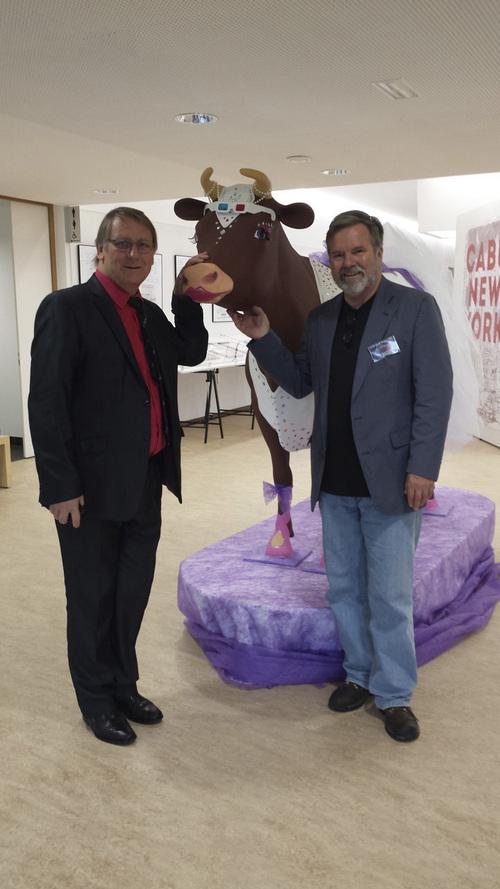 Salt Lake Tribune cartoonist, Pat Bagley, with St-Just-le-Martel mayor, Gerard Vandenbroucke, and cow.