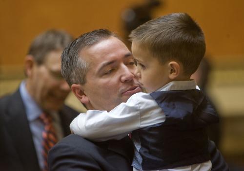 Al Hartmann  |  Tribune file photo Rep. Dan McCay, R-Riverton, with son on the House floor.