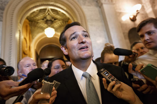 """Sen. Ted Cruz, R-Texas talks to reporters as he emerges from the Senate Chamber on Capitol Hill in Washington, Wednesday, Sept 25, 2013, after his overnight crusade railing against the Affordable Care Act, popularly known as """"Obamacare."""" Cruz ended the marathon Senate speech opposing President Barack Obama's health care law after talking for 21 hours, 19 minutes.  (AP Photo/J. Scott Applewhite)"""