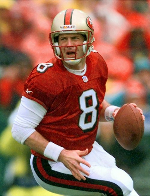 San Francisco 49ers quarterback Steve Young rolls back looking for room to pass during the opening minutes of the NFC Championship game agaisnt the Green Bay Packers in San Francisco in this Jan. 11, 1998 file photo.  (AP Photo/Susan Ragan)