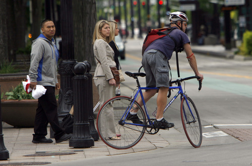 Francisco Kjolseth     The Salt Lake Tribune Bicyclists make their way through down town traffic on Monday, April 30, 2012. In 2012, Salt Lake City issued fewer citations to bicyclists than in the prior five years.